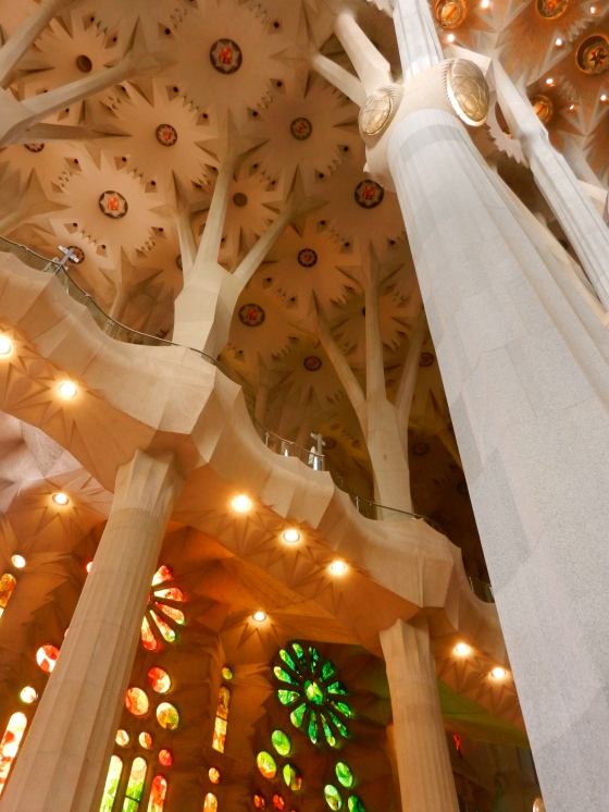 Large columns of the church support the enormous ceiling and look like tree trunks with branches