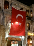 Turkish flag hangs from buildings lining Indepence Blvd, the night spot for city dwellers