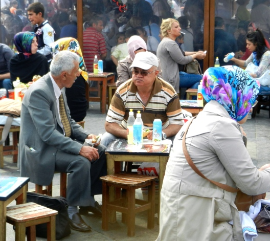 Turkish men love to enjoy lunch at these little tables set up around town