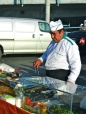 Street vendors prepare fresh fish daily
