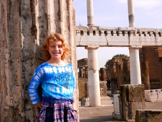 Lilly strikes a pose in the Forum, Pompeii