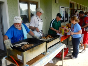 German booster club cooks up sausages for hungry walkers
