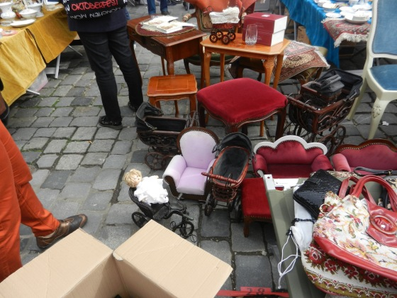 A mishmash of things to consider: doll toys, stools, chairs and ceramics