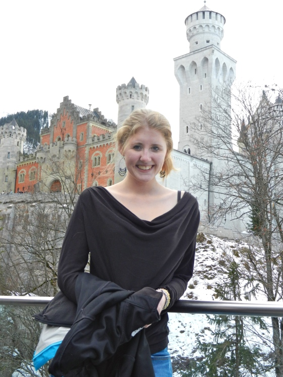 Lindsey poses in front of her fairy tale castle