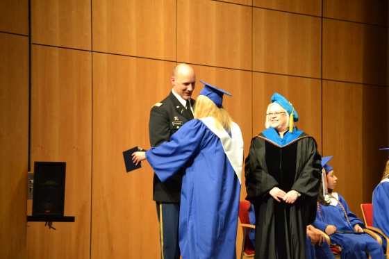 Lauren receiving her diploma from Dr Brezel and LTC Strange