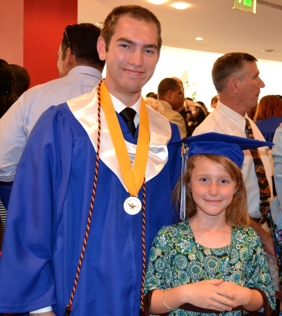 Andrew Becker and Lilly following graduation