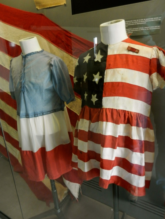 Children's dresses made from parachute silk and American flags to celebrate liberation of Paris France