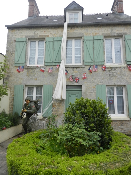 Home in St Mere Eglise decorated to show what it may have looked like when 82nd Airborne landed