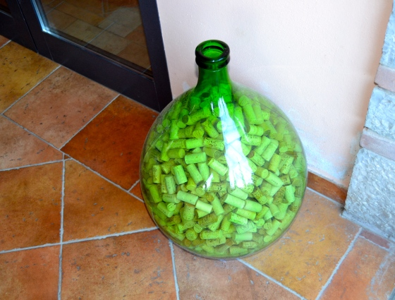 Old glass bottle full of wine corks
