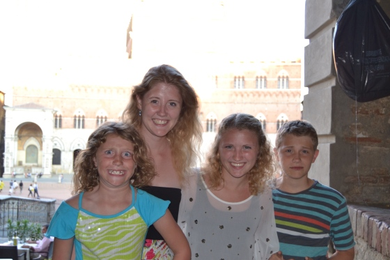The kids pose before dinner in Siena