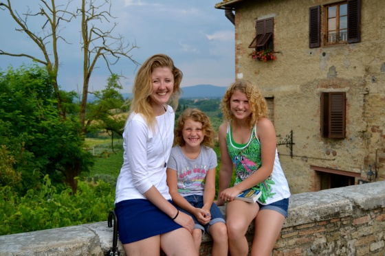 The girls pose outside San Gimignano before heading home