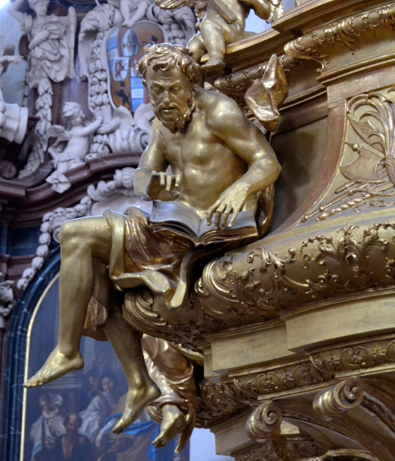 Saint perched precariously on the edge of the pulpit