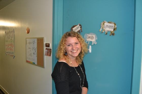 Lauren pauses in front of her freshman dorm room.