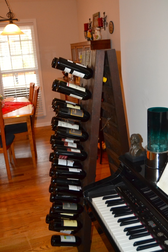 The riddling rack is a narrow A-frame stand created to hold wine bottles, 30 on each side