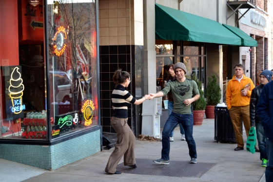 This couple couldn't resist a little swing dancing on the street