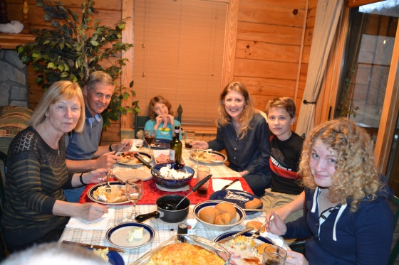 The whole gang gathered around the kitchen table for a tasty meal at the Lake Lure cabin