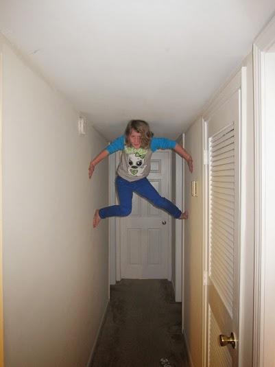 """""""I'm really good at climbing walls.  Here I am at Lindsey's apartment."""""""