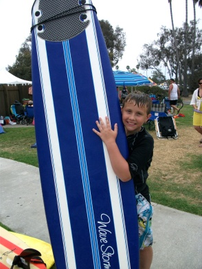 Will poses with his board after his lesson