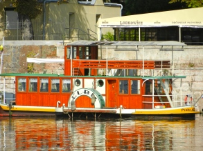Quaint old boat on the Vltava River