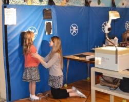 "Art teacher helps create ""silhouettes"" of the kids"