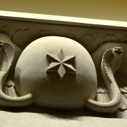 Serpents guard the elevator entry