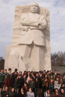 A school group poses in front of the MLK Monument