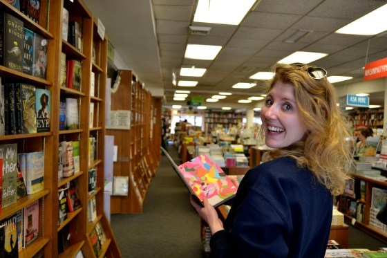 Lindsey is the first to grab a book from the top shelf