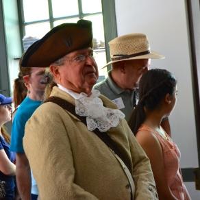 "Costumed guides regularly pose as ""regular folk"" in various Williamsburg shops"